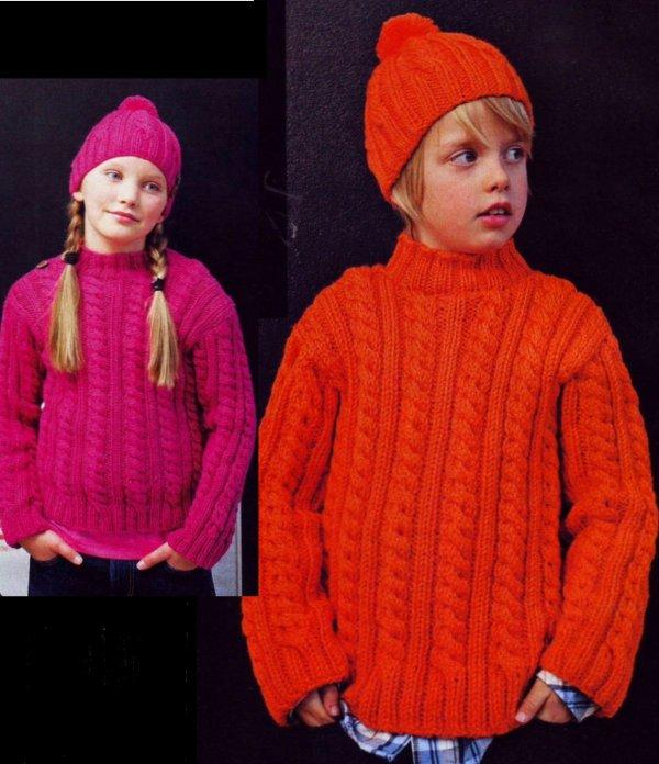 012 Детский пуловер с косами.